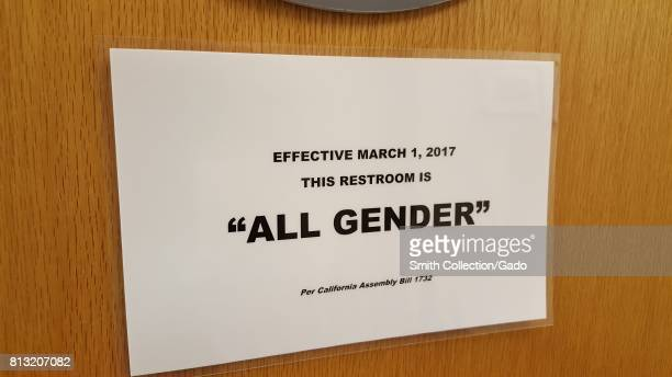 Closeup of a sign on the door of a public restroom indicating that the restroom is 'All Gender' as of March 2017 as a result of California Assembly...