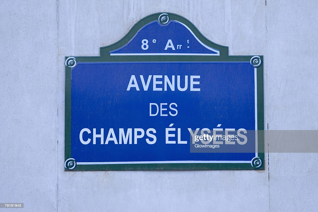 Close-up of a signboard on a wall, Avenue Des Champs-Elysees, Paris, France : Stock Photo