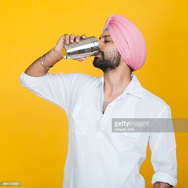 Close-up of a Sikh man drinking lassi
