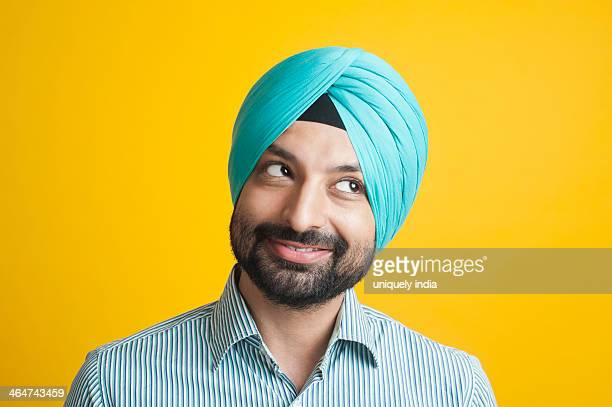 Close-up of a Sikh man smiling