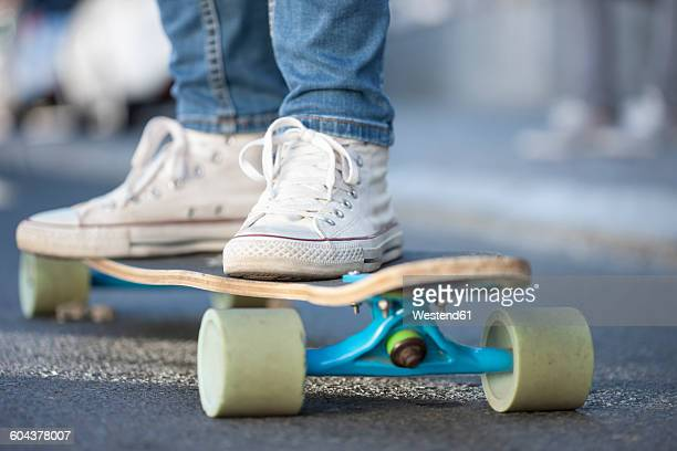 close-up of a skateboarder - girl shoes stock pictures, royalty-free photos & images