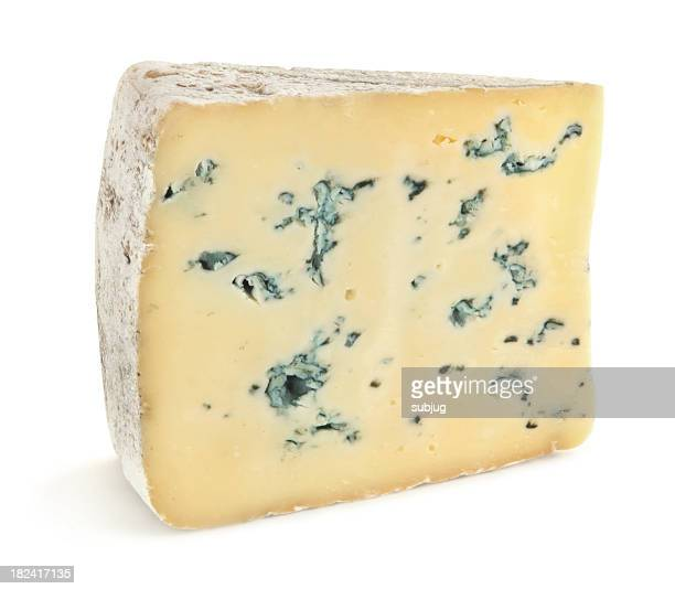 Close-up of a slice of blue cheese on a white background