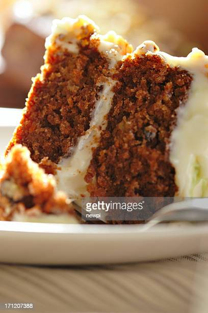 Close-up of a slice of carrot cake with cream