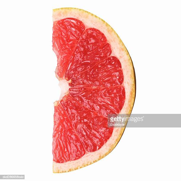 close-up of a slice of pink grapefruit - grapefruit red stock pictures, royalty-free photos & images