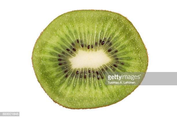 closeup of a sliced kiwifruit isolated - bisected stock pictures, royalty-free photos & images