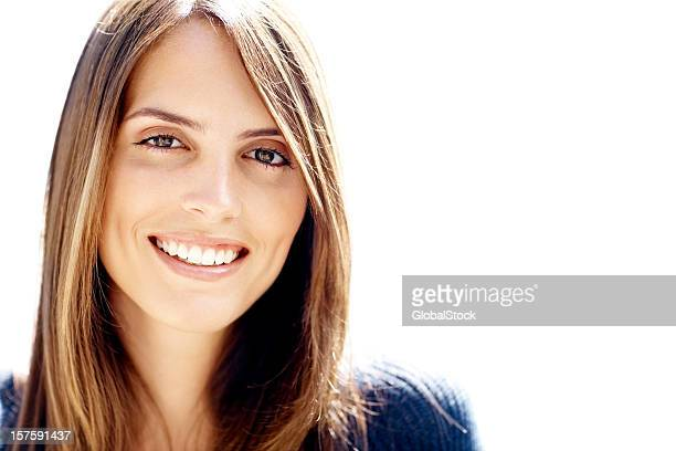 Close-up of a smiling brunette female