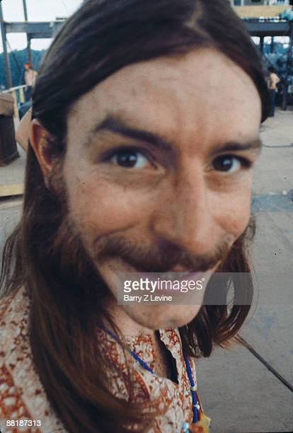 CLoseup of a smiling unidentified man on the stage at the Woodstock Music and Arts Fair in Bethel New York August 15 17 1969