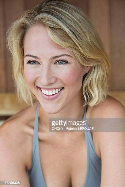 close-up of a smiling woman in a sauna - cleavage close up stock photos and pictures