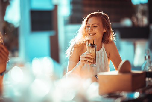 Close-Up Of A Smiling Young Woman Drinking Drink - gettyimageskorea