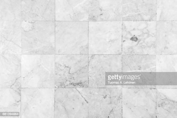 close-up of a smooth marble floor viewed from above in black&white. - pavimento di mattonelle foto e immagini stock