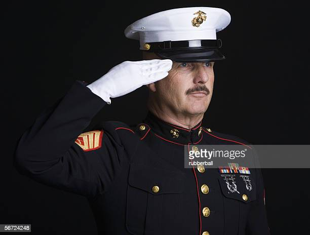 close-up of a soldier saluting - uniform cap stock pictures, royalty-free photos & images