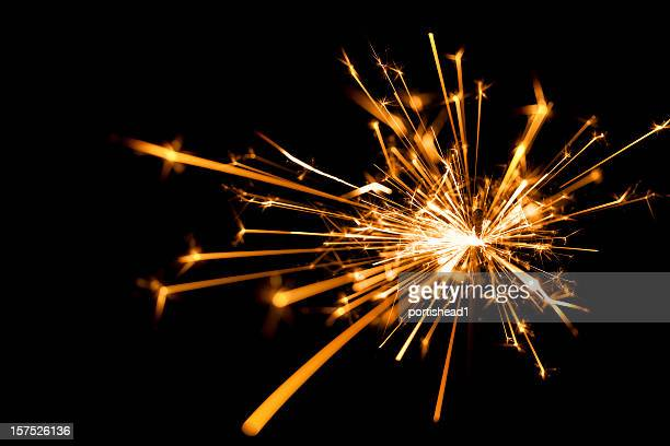 Close-up of a sparkler on black background