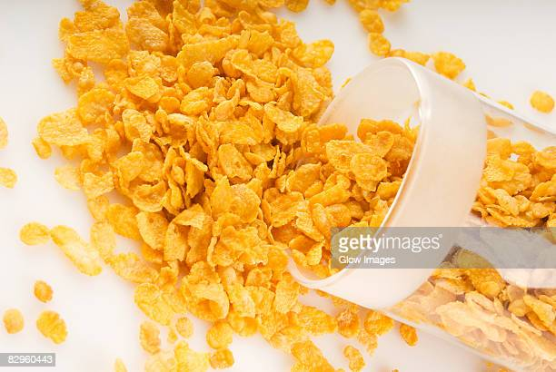 Close-up of a spilled jar of corn flakes