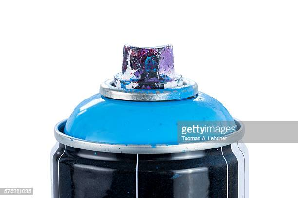 Close-up of a spray paint can with painty nozzle