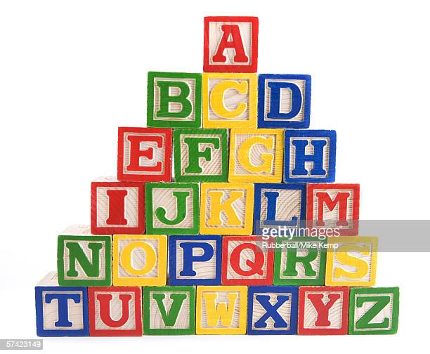 Close-up of a stack of alphabet blocks