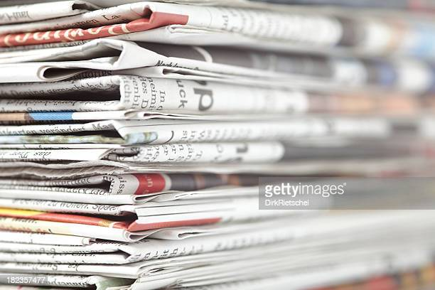 Close-up of a stack of newspapers