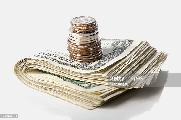 close-up of a stack of paper currency and coins - us coin stock pictures, royalty-free photos & images