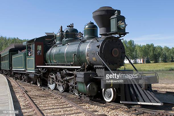 close-up of a steam-powered train on its tracks - steam train stock pictures, royalty-free photos & images