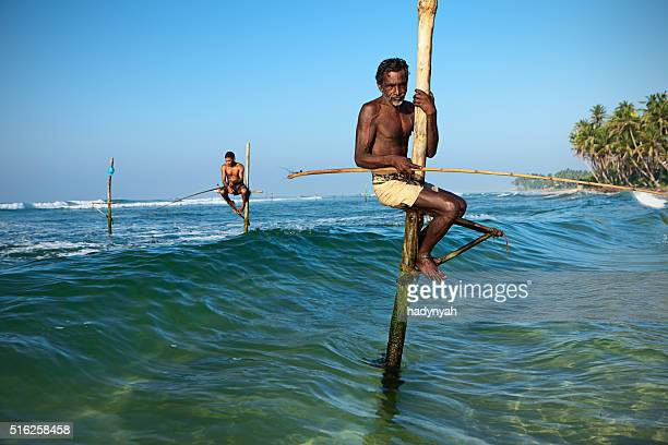 Close-up of a stilt fishermen in action, Ceylon