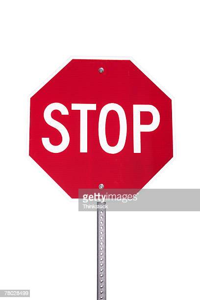 Close-up of a stop sign silhouetted on a white background