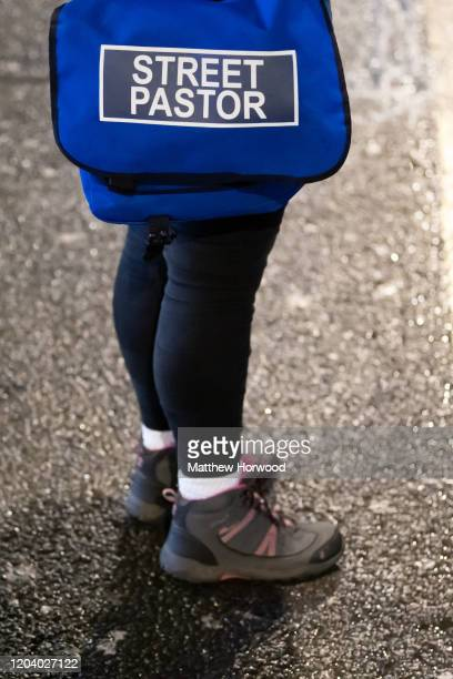 Close-up of a street pastor on December 20, 2019 in Cardiff, United Kingdom. Street pastors, often volunteers from local church groups, walk the...
