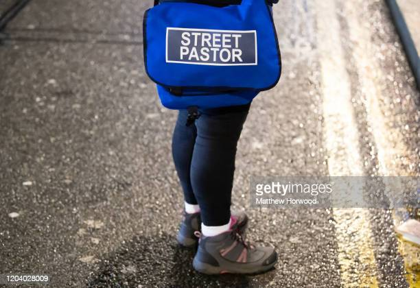 A closeup of a street pastor on December 20 2019 in Cardiff United Kingdom Street pastors often volunteers from local church groups walk the streets...