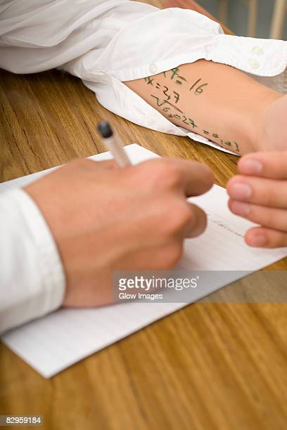 close-up of a student copying in an examination - dishonesty stock pictures, royalty-free photos & images