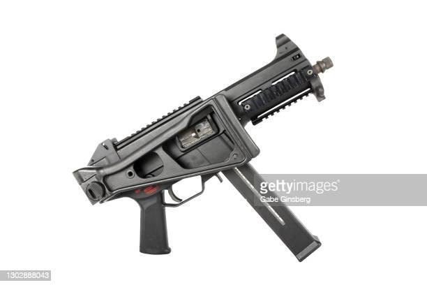 close-up of a submachine gun with a folded stock on a white background - gun stock pictures, royalty-free photos & images