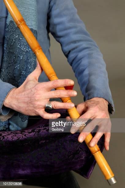 Closeup of a sufi musician playing a ney Paris France