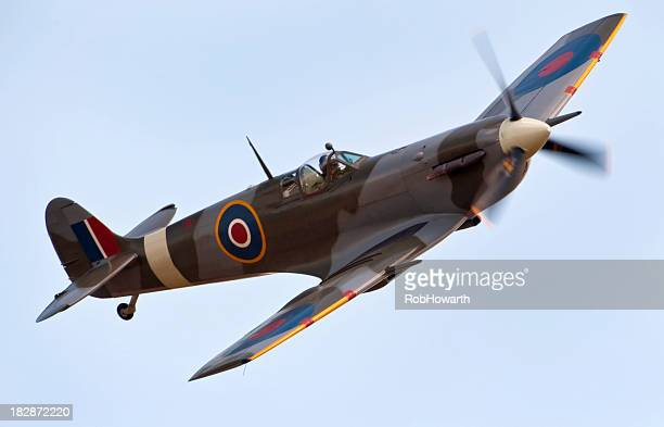 a close-up of a supermarine spitfire aircraft in flight - world war ii stock pictures, royalty-free photos & images