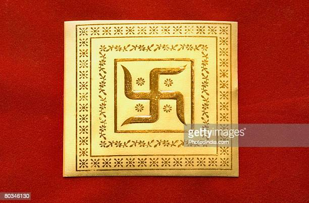 Close-up of a swastika on a wedding invitation card