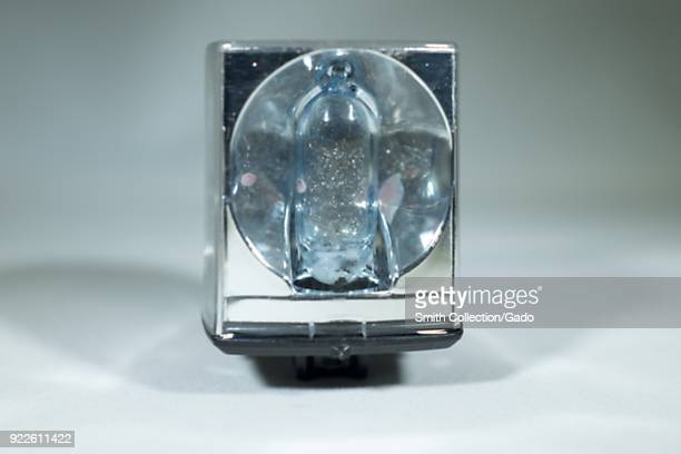 Closeup of a Sylvania Blue Dot Magicube an early foursided flash cube used with 1970s era Kodak Instamatic Cameras showing metal foil flash element...