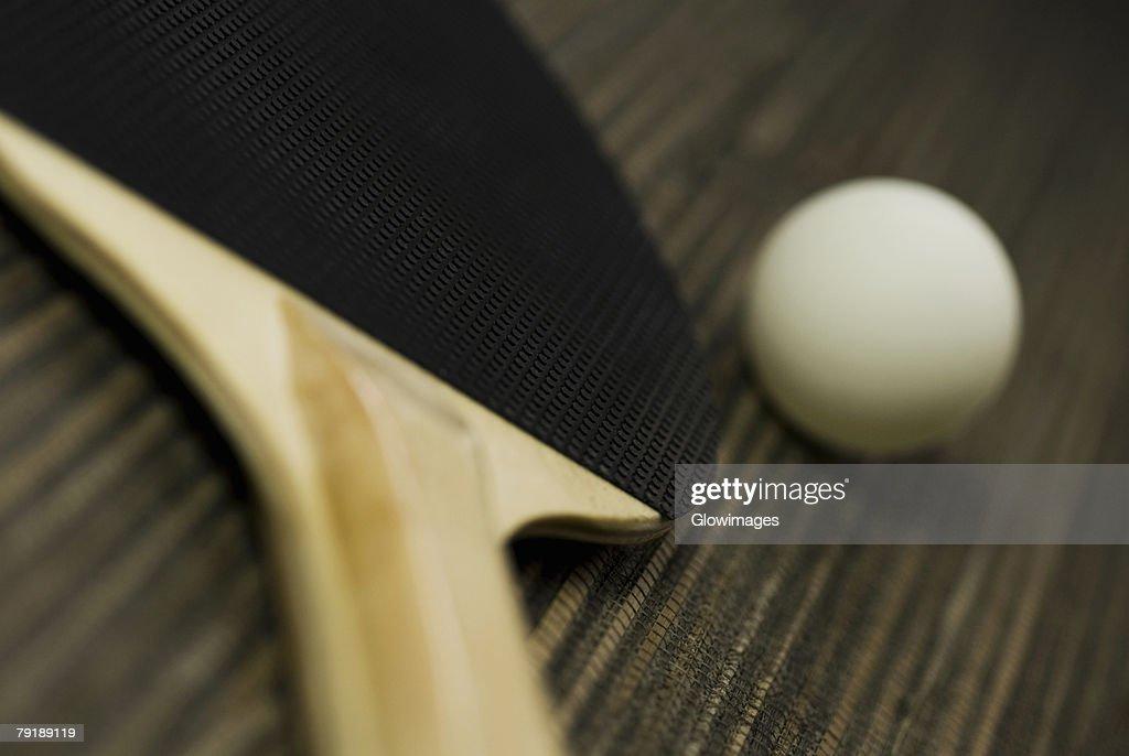 Close-up of a table tennis ball with a table tennis racket : Stock Photo