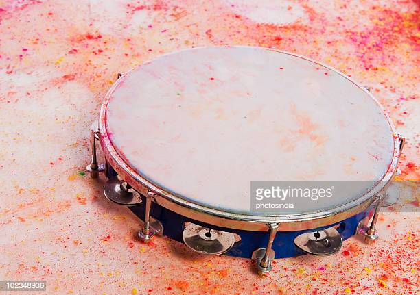 Close-up of a tambourine with Holi colors