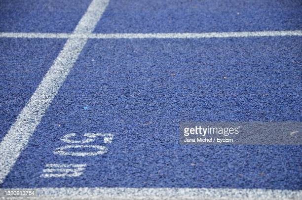 close-up of a tartan track - olympiastadion berlin stock pictures, royalty-free photos & images