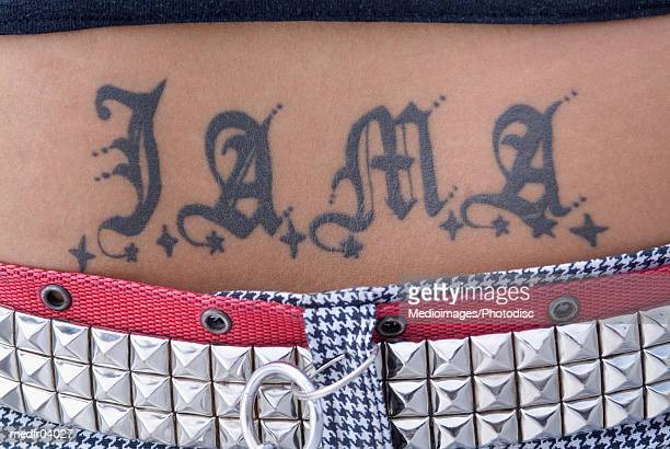 Close-up of a tattoo on a persons waist
