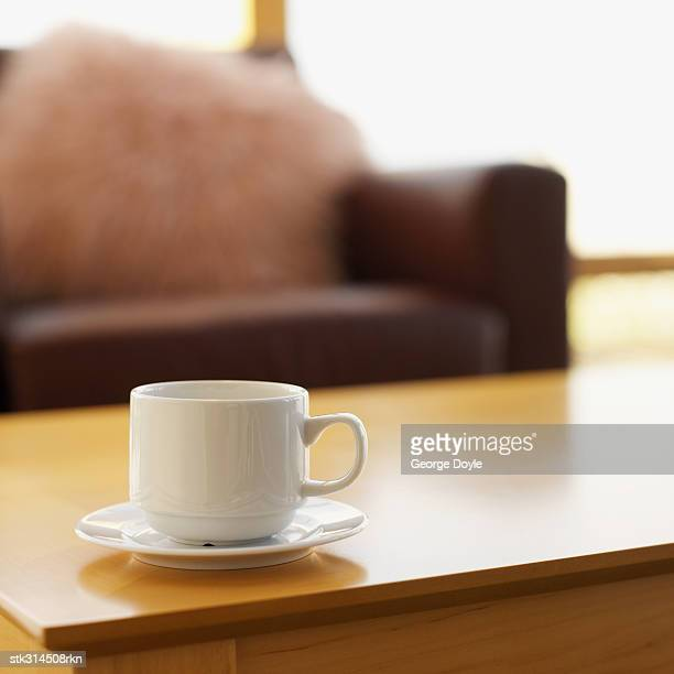 close-up of a tea cup and a saucer on a table