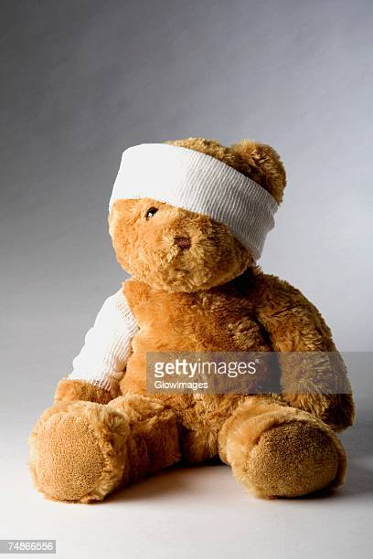 Close-up of a teddy bear with a bandage