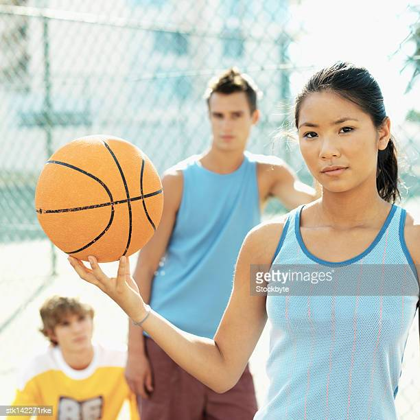 close-up of a teenage girl holding a basketball