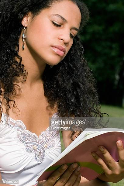 Close-up of a teenage girl reading a book