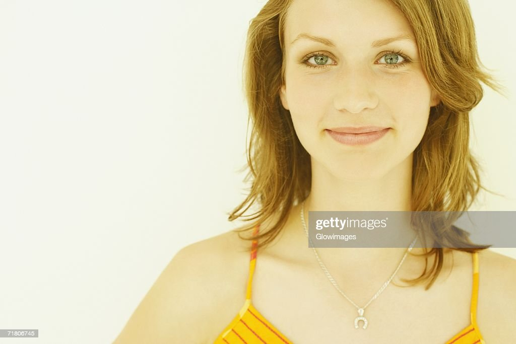 Close-up of a teenage girl smiling : Stock Photo