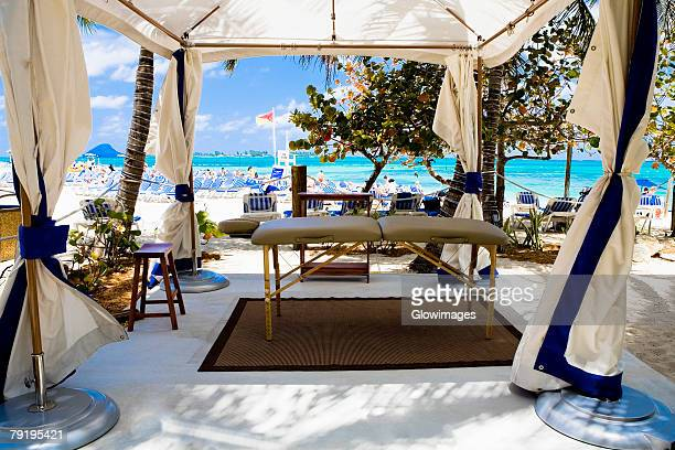 close-up of a tent on the beach, cable beach, nassau, bahamas - cable beach bahamas stock photos and pictures