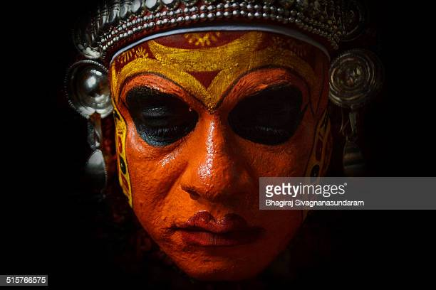 Closeup of a Theyyam while he was calmly preparing himself mentally for the act that will go on till the next morning. Theyyam or Thira is a popular...