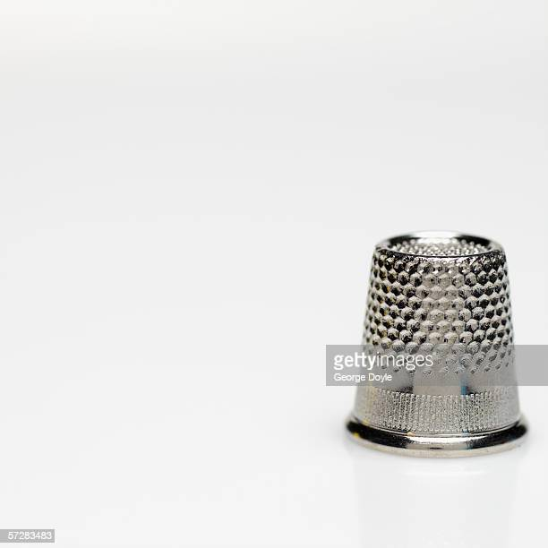 close-up of a thimble - thimble stock photos and pictures