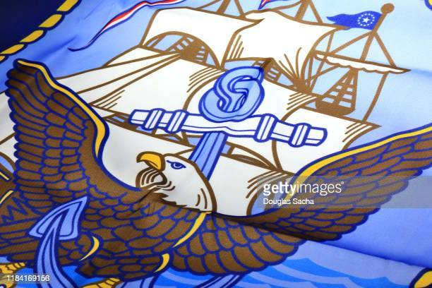 close-up of a us navy flag - us military emblems stock pictures, royalty-free photos & images