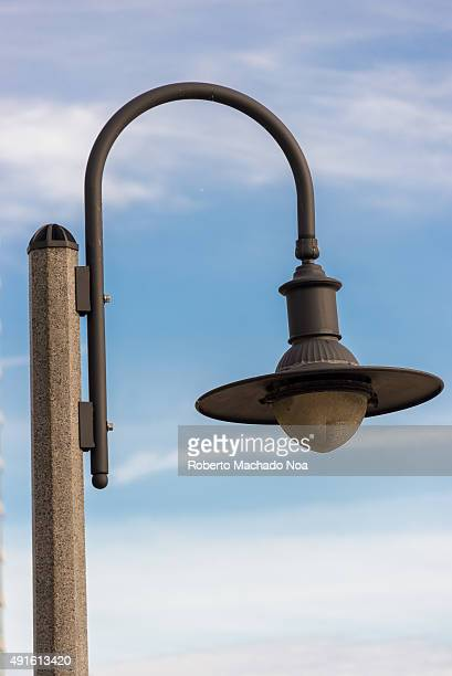 Decorative street light poles getty images closeup of a vintage streetlamp fixed on a lamp post against the sky in the background mozeypictures Images