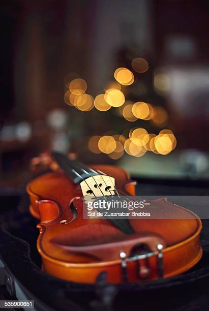 Closeup of a violin on a background of small balls