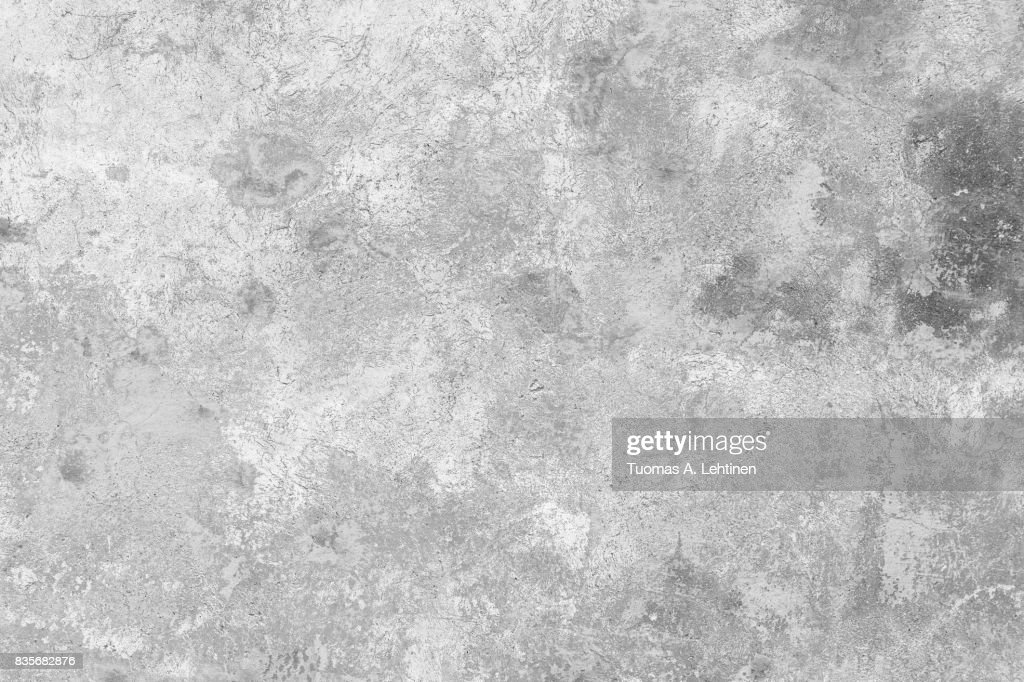 Close-up of a weathered and aged concrete wall, paint partly peeled off. Texture background in black and white. : Stock Photo