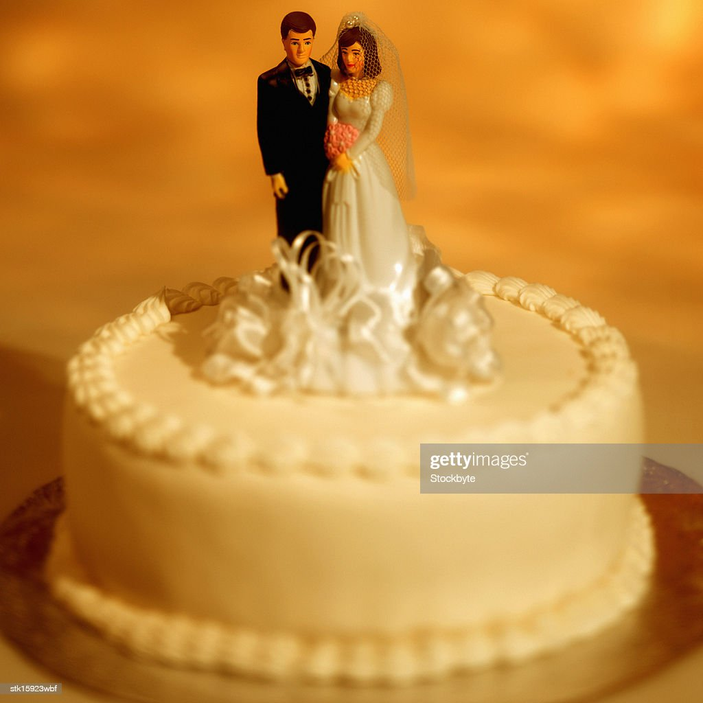 Closeup Of A Wedding Cake With Bride And Groom Figures On It Stock ...