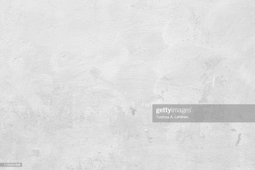 Closeup of a white concrete wall : Stock Photo